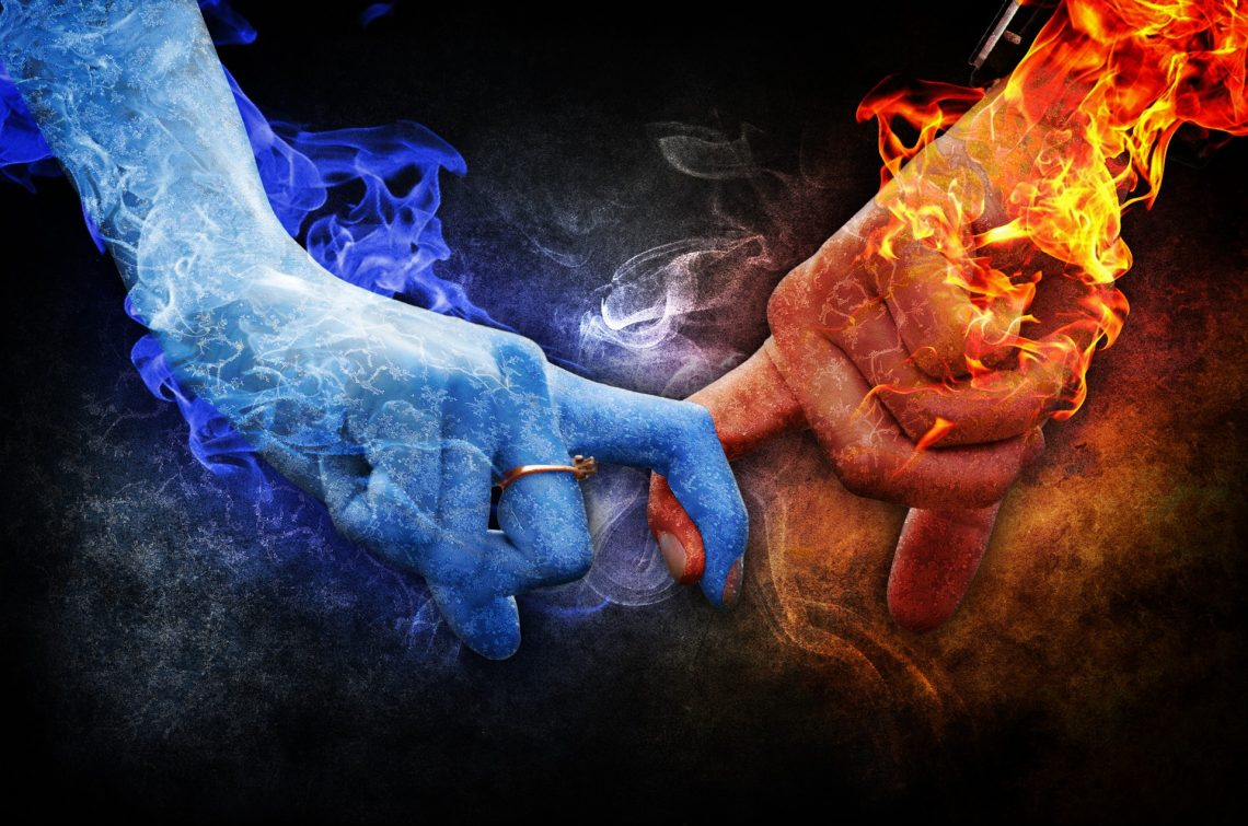 artistic image of two hands linked symbolizing passionate connection
